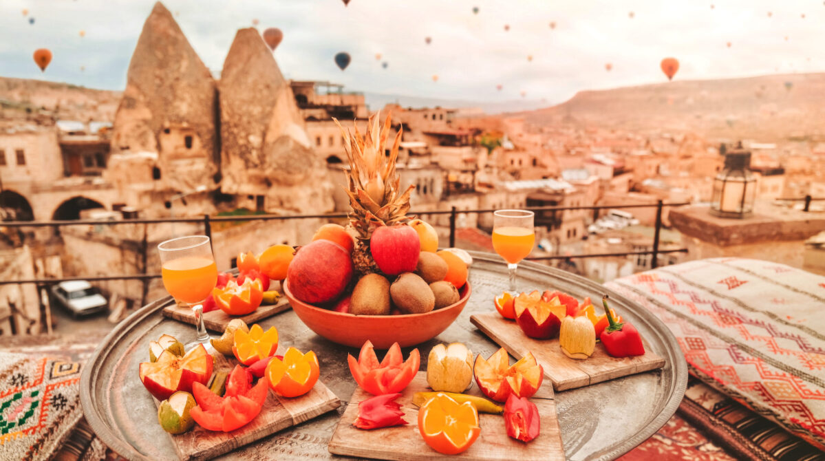 Travel in Cappadocia Colorful hot air balloons flying over the valley sunrise time with  special breakfast travel destination in Turkey