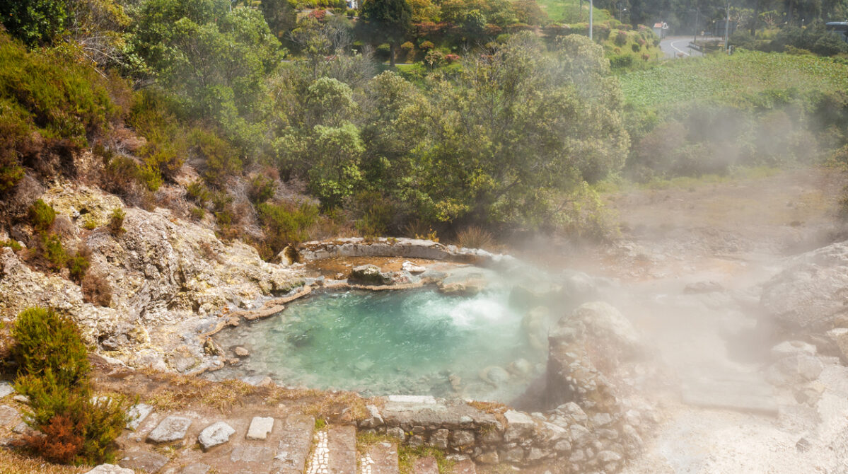 One of the many geysers, hot-springs and fumaroles scattered in the center of the village of Furnas, Sao Miguel Island, Azores